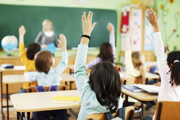 Portrait of back - Children are raised hands in classroom.   [url=http://www.istockphoto.com/search/lightbox/9786682][img]http://img638.imageshack.us/img638/2697/children5.jpg[/img][/url]