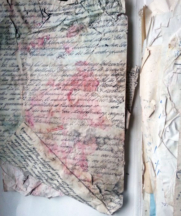 Newly discovered documents in the Lithuanian Central State Archive from YIVO's prewar collection, now in the process of being sorted and conserved. Their damaged appearance is testament to the circumstances in which they rescued and hidden