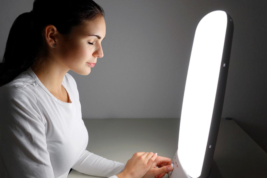Woman receiving light therapy.
