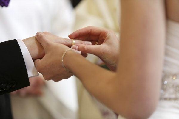 Bride and groom during wedding rings exchange