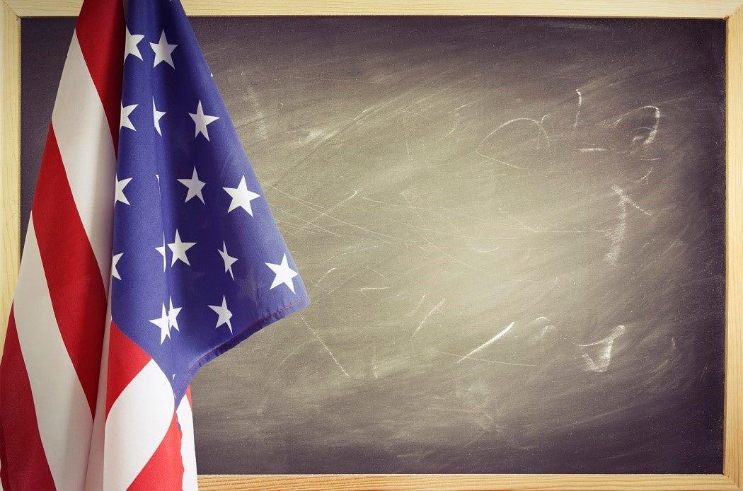 American flag in front of blackboard