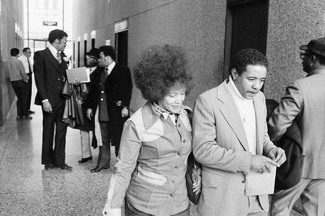 "Linda Taylor, 49, the so-called ""welfare queen"", was sentenced to serve two-to-six years in prison in Chicago, May 13, 1977. She is shown on her way to sentencing. Taylor was convicted March 17 of theft and perjury. Man escorting her is unidentified. (AP Photo)"
