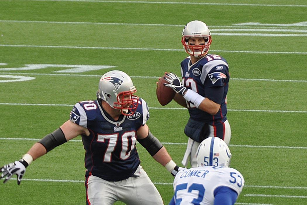 """Tom Brady and his offensive line"" by Jack Newton - Flickr: Tom Brady looks downfield. Licensed under CC BY-SA 2.0 via Wikimedia Commons - http://commons.wikimedia.org/wiki/File:Tom_Brady_and_his_offensive_line.jpg#/media/File:Tom_Brady_and_his_offensive_line.jpg"