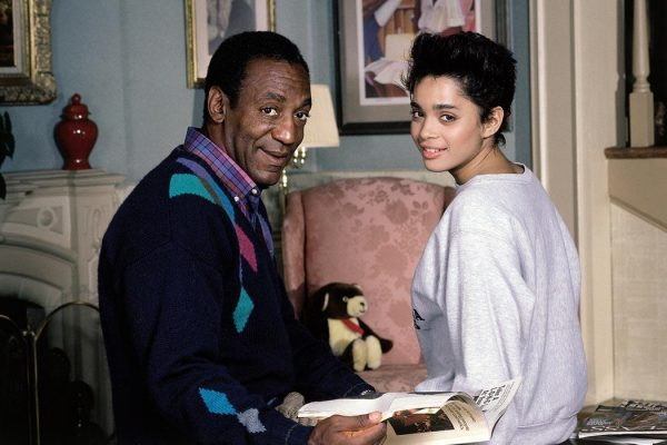 Bill Cosby sitting across from Lisa Bonet