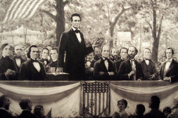 """Lincoln debating Douglas"" by Cool10191. Licensed under Public Domain via <a href=""https://commons.wikimedia.org/wiki/File:Lincoln_debating_douglas.jpg#/media/File:Lincoln_debating_douglas.jpg"" target=""_blank"">Wikimedia Commons</a>"