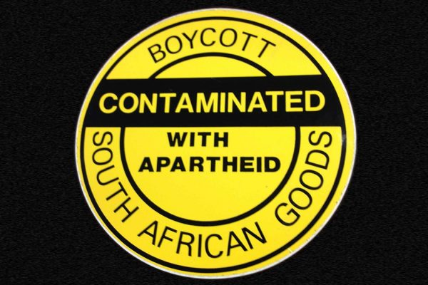 """Boycott - Contaminated with apartheid - South African goods"" by Djembayz - Own work. Licensed under CC BY-SA 3.0 via Commons - https://commons.wikimedia.org/wiki/File:Boycott_-_Contaminated_with_apartheid_-_South_African_goods.jpg#/media/File:Boycott_-_Contaminated_with_apartheid_-_South_African_goods.jpg"