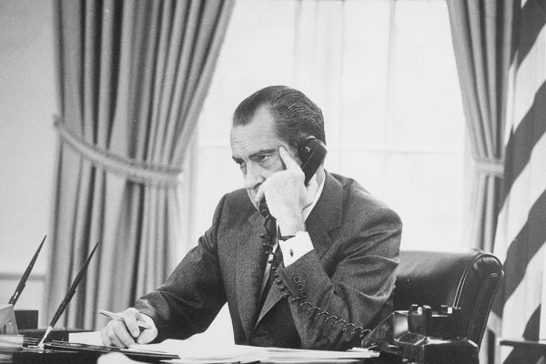 """Richard M. Nixon on the phone in the oval office - NARA - 194744"" by Oliver F. Atkins, 1916-1977, Photographer (NARA record: 8451334) - U.S. National Archives and Records Administration. Licensed under Public Domain via Wikimedia Commons"
