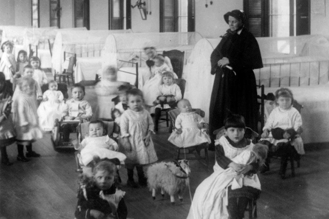 "Sister Irene and children at New York Foundling orphanage  ""Children at New York Foundling cph.3a23917"" by Jacob Riis - This image is available from the United States Library of Congress's Prints and Photographs division under the digital ID cph.3a23917. Licensed under Public Domain via <a href=""https://commons.wikimedia.org/wiki/File:Children_at_New_York_Foundling_cph.3a23917.jpg#/media/File:Children_at_New_York_Foundling_cph.3a23917.jpg"" target=""_blank"">Wikimedia Commons</a>"
