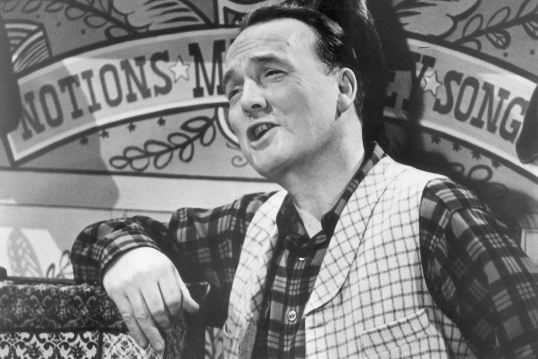 circa 1955:  American humorist and author John Henry Faulk (1913 - 1990), narrates the history of early America in a still from the television program,'They Call It Folk Music.'  (Photo by Hulton Archive/Getty Images)