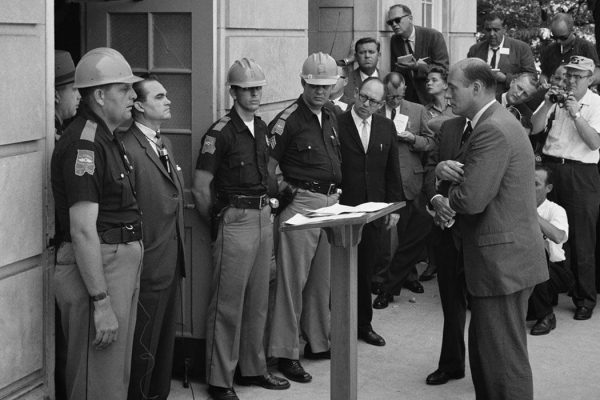 Attempting to block integration at the University of Alabama, Governor of Alabama George Wallace stands at the door of the Foster Auditorium while being confronted by United States Deputy Attorney General Nicholas Katzenbach.