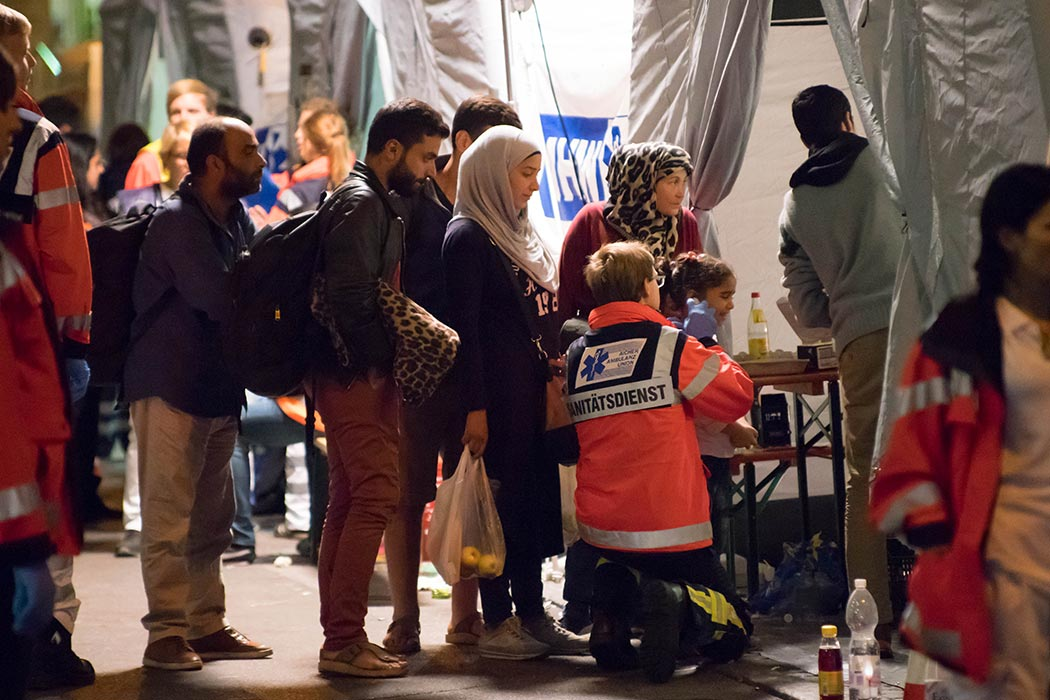 A refugee family seen arrives at the Munich railway station before being checked by the medical staffs. - Thousands of refugees mainly from Iraq and Syria continue to flood in to Munich railway station in southern Germany as trains arrive from Budapest and Vienna. 8th September 2015 (Photo by Geovien So/NurPhoto)  Credit: Associated Press