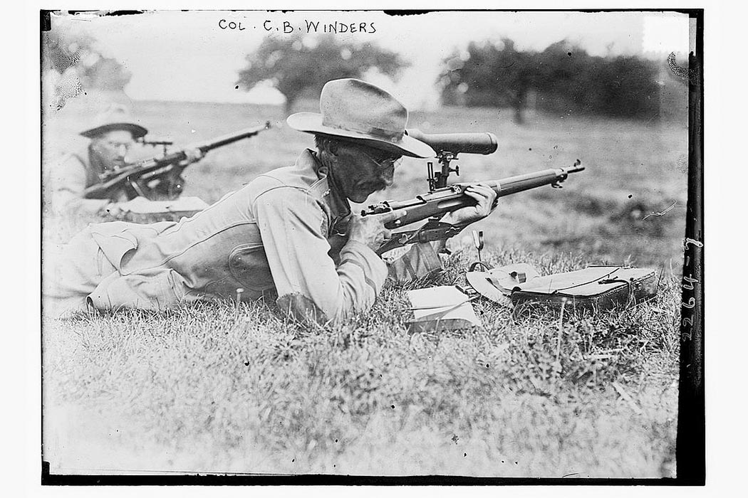 New York area marksman C.B. Winder shooting a gun.  Photo Credit: George Grantham Bain Collection (Library of Congress)