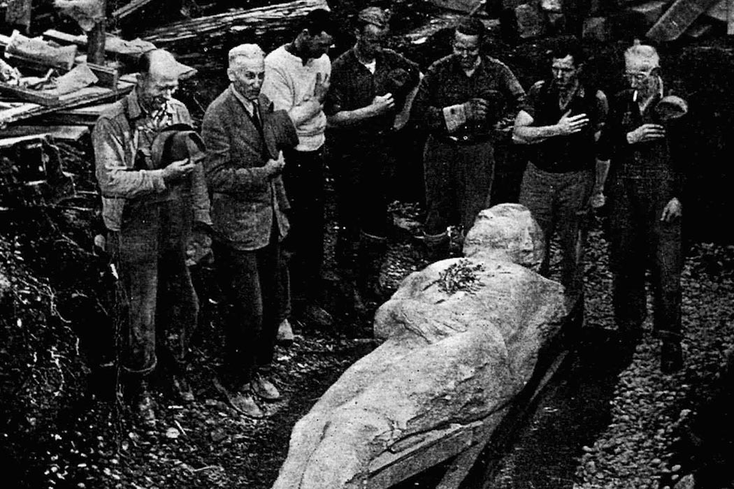 "Workers are dwarfed by the 10-foot Cardiff Giant as they dig him out of his ""grave"" in Cardiff, N.Y., in this 1869 file photo. AP Photo/Farmers Museum, HO)"