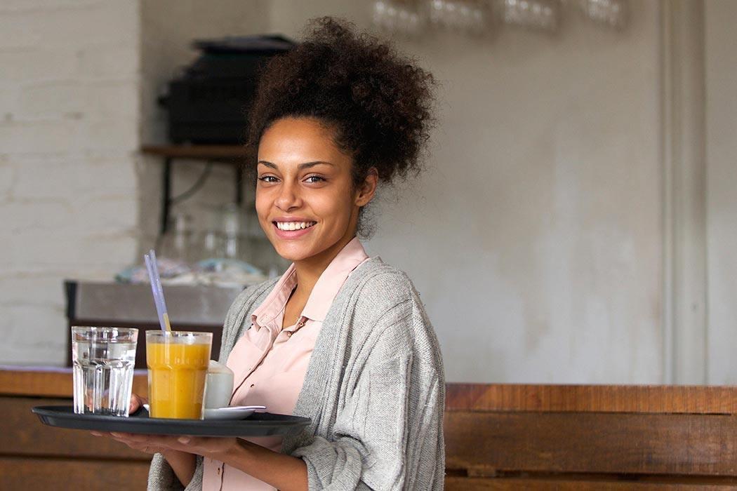 Smiling waitress making minimum wage.