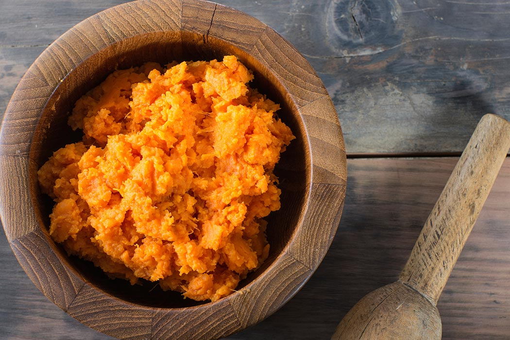 A bowl of mashed sweet potatoes.