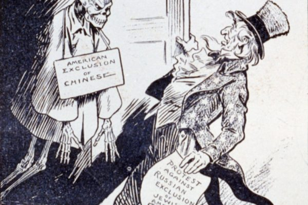 "Uncle Sam holding paper ""Protest against Russian exclusion of Jewish Americans"" and looking in shock at Chinese skeleton labeled ""American exclusion of Chinese"" in closet."