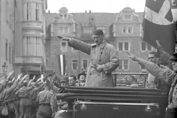 Hitler salutes marching Nazis in Weimar – Oct 1930