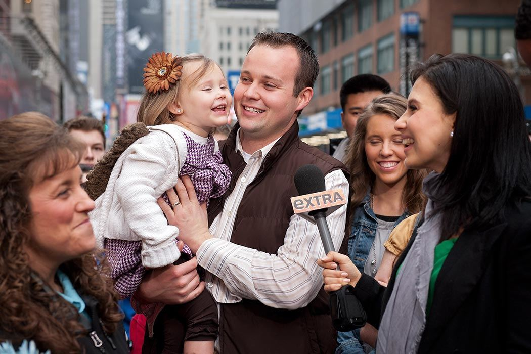 "Hilaria Baldwin (R) interviews Josh Duggar and his daughter during their visit with ""Extra"" in Times Square on March 11, 2013 in New York City. (Photo by D Dipasupil/Getty Images for Extra)"