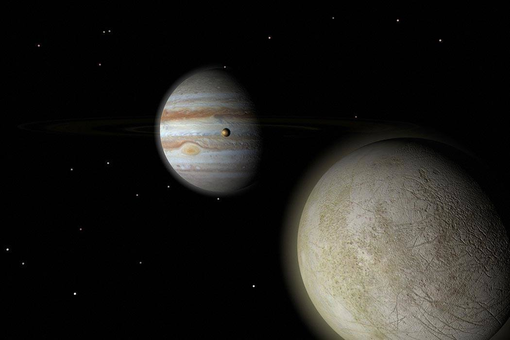 Jupiter with moons, Europa and Io.