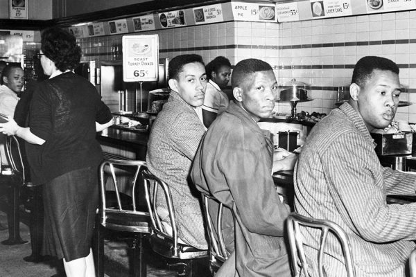 African-American students at North Carolina A&T College participate in a sit-in at a F. W. Woolworth's lunch counter reserved for white customers in Greensboro, North Carolina. (Copyright Bettmann/Corbis / AP Images)