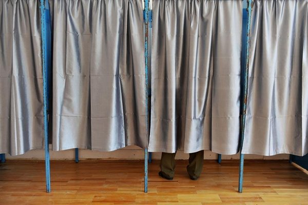 Man inside a voting booth.