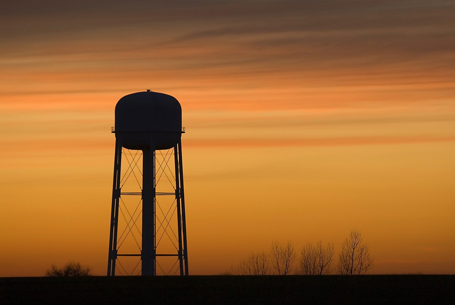 A water tower at sunset.