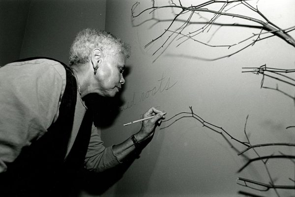 """Award-winning artist Betye Saar, shown here setting up her """"Tangled Roots"""" exhibit at the Palmer Museum of Art on the University Park campus of Penn State in 1996."""