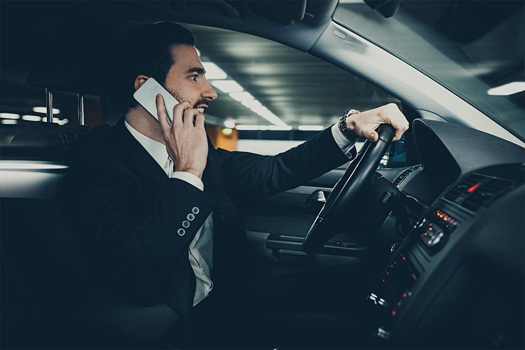 Businessman commuting to work in his car.