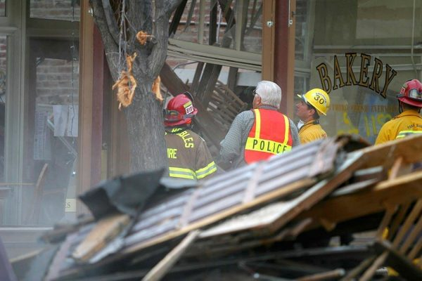 PASO ROBLES, CA - DECEMBER 22: Rescue workers survey damage while searching for survivors December 22, 2003 in Paso Robles, California. The 6.5 richter scale earthquake hit the central coast of California earlier today killing at least two people. (Photo by Rod Rolle)