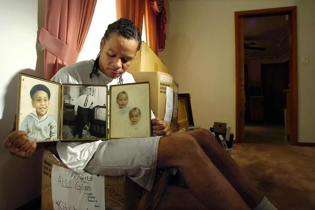 "Abriel Thomas, a cousin of Emmett Till, holds a triptych showing childhood photos of Till in his Chicago home Monday, May 10, 2004, after news that federal authorities are reopening the investigation into the 14-year-old's 1955 race-motivated murder. ""I wish Mamie could have been here,"" Thomas said. ""It was the only thing she ever wanted out of life _ a little bit of justice."" (AP Photo/Jeff Roberson)"