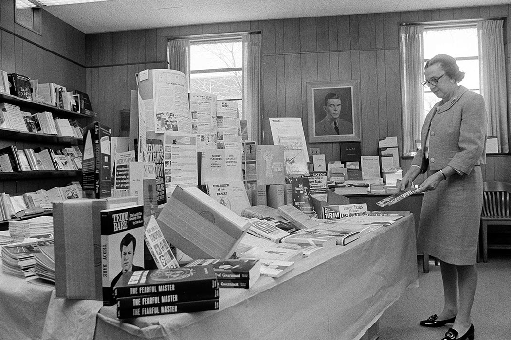 Mrs. Rose O'Brine works in the bookstore at the John Birch Society in Belmont, Mass., April 14, 1976. (AP Photo/J. Walter Green)
