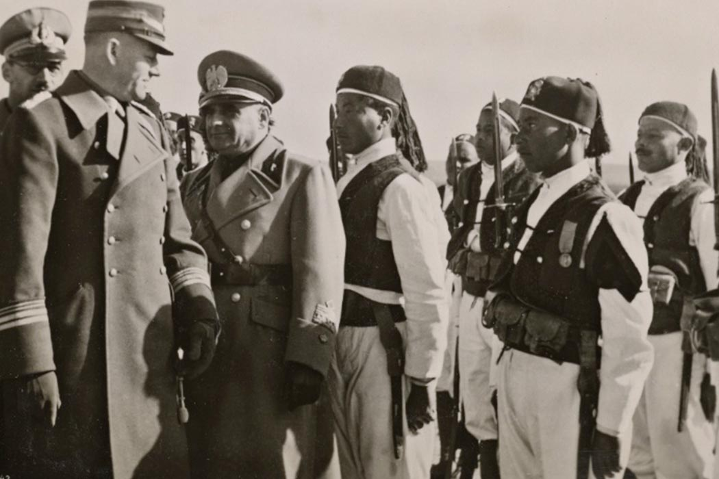Chief of Staff Lutze visits the new Italian settlements in Libya. The Chief of Staff and His Excellency Russo inspect ranks of Askaris (native soldiers) in Nalut.