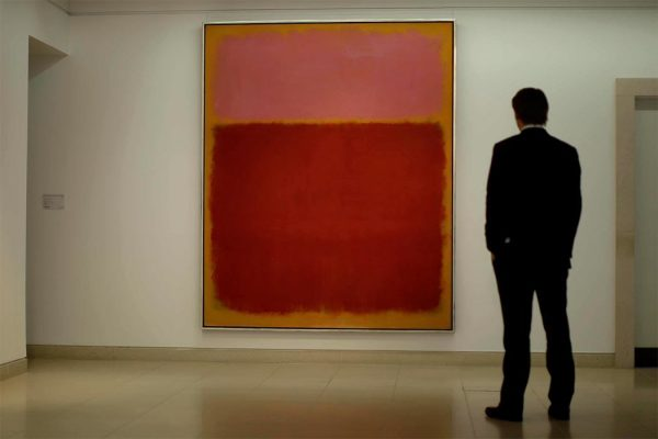 "Christie's employee Matt Paton poses for photographs in front of Mark Rothko's ""Untitled #17"" at the auction house's premises in London, Friday, April 15, 2011. The painting is is estimated to fetch between 11 to 14 million pounds ($18 to 22 million, 12.5 to 16 million euro) when it comes up for auction in New York in May. (AP Photo/Matt Dunham)"