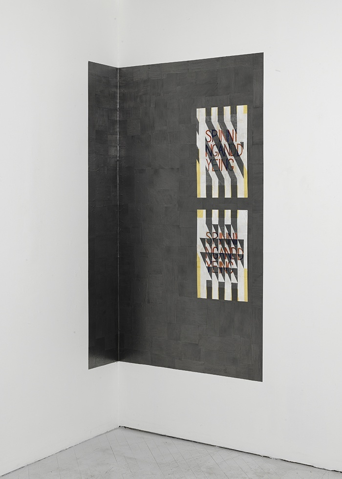 "In the background is a site specific studio version of ""Evidence of the Material World,"" (2010 - present) an ongoing project where a graphite membrane is applied directly on the wall of a given site. On top of this iteration is ""Spinning and Dyeing #1 & #2,"" (2014) each measuring 22"" x 14"""