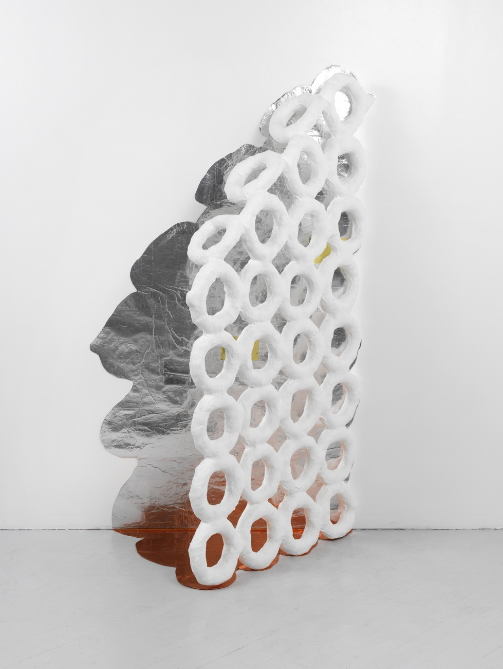 """Prosodies #2"" (2013), 72"" x 34"" x 22""; embroidery loops, plaster, paint, cloth, paper, metal, cellophane"
