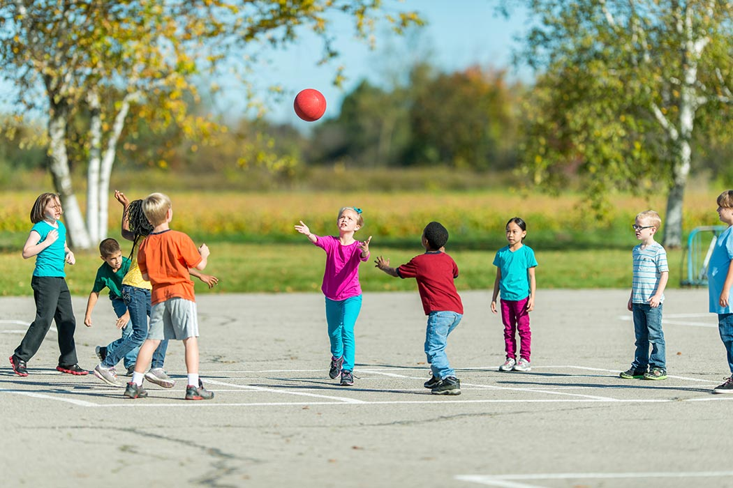 Children playing in the schoolyard during recess.
