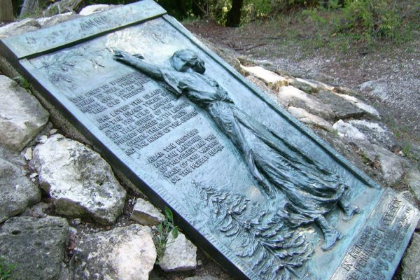 Anne's Tablet (1916) by William Ordway Partridge to honor Constance Fenimore Woolson, Mackinac Island, Michigan.