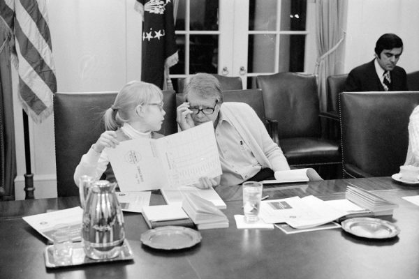 Amy Carter and Jimmy Carter participate in a speed reading course at the White House, February 22, 1977.