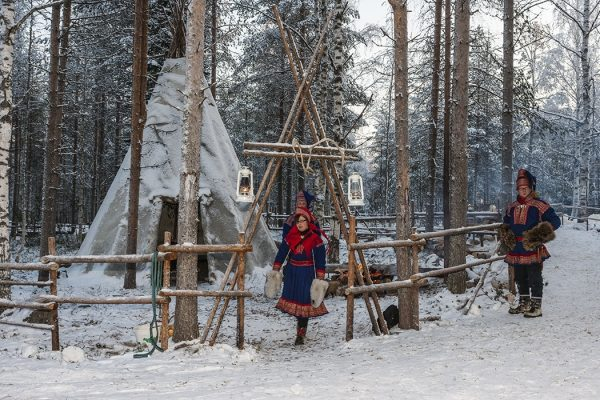 "Finland. Province of Lapland (Lapin lääni). Two Sami people near their ""lavvu"", a temporary dwelling similar to a Native American tipi. The Sami people (or Saami) live in Lapland and other areas north of the Arctic Circle, including northern Norway, Sweden, Finland, Russia (the Kola Peninsula). They call their land ""Sápmi"". They are the only people of Scandinavia recognized and protected under the international conventions of indigenous peoples. The Sami languages (like the Finnish language) are classified as a branch of the Uralic language family."