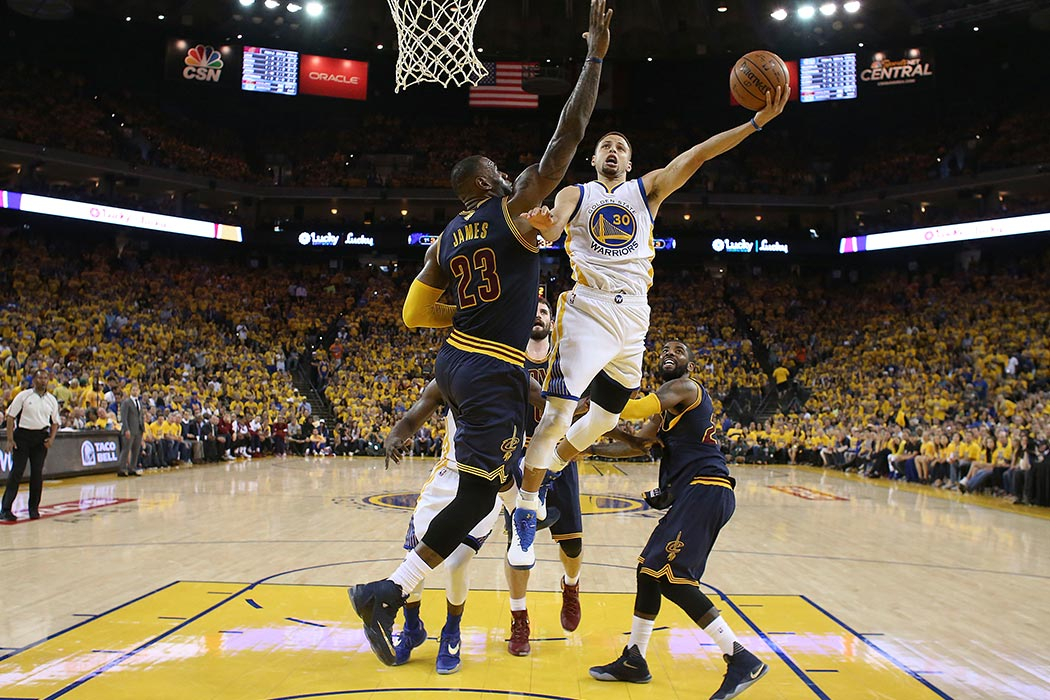 Golden State Warriors guard Stephen Curry (30) shoots against Cleveland Cavaliers forward LeBron James (23) during the first half of Game 2 of basketball's NBA Finals in Oakland, Calif., Sunday, June 5, 2016. (Ezra Shaw, Getty Images via AP, Pool)