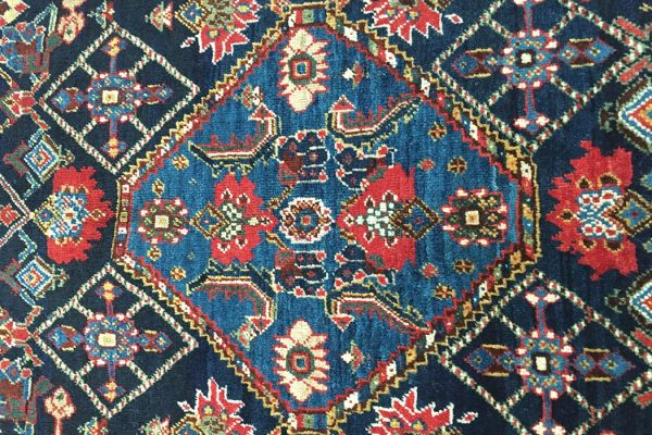 Central medallion of a Qashqai rug, 19th century, with fragmented Herati pattern.