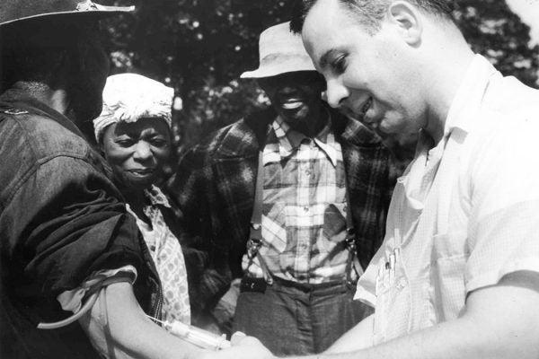 Unidentified subject, onlookers and Dr. Walter Edmondson taking a blood test (NARA, Atlanta, GA)