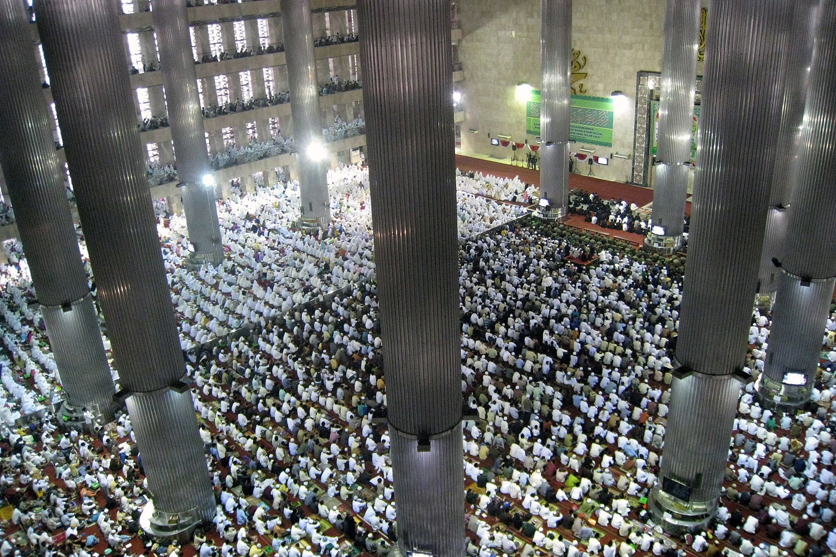 Photograph: Thousands of the Indonesian muslims congregrated during Eid ul Fitr mass prayer in Istiqlal Mosque, the largest mosque in Southeast Asia, located in Central Jakarta, Indonesia.