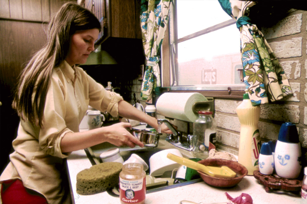 A woman in the kitchen of her mobile home in New Ulm, Minnesota, 1974
