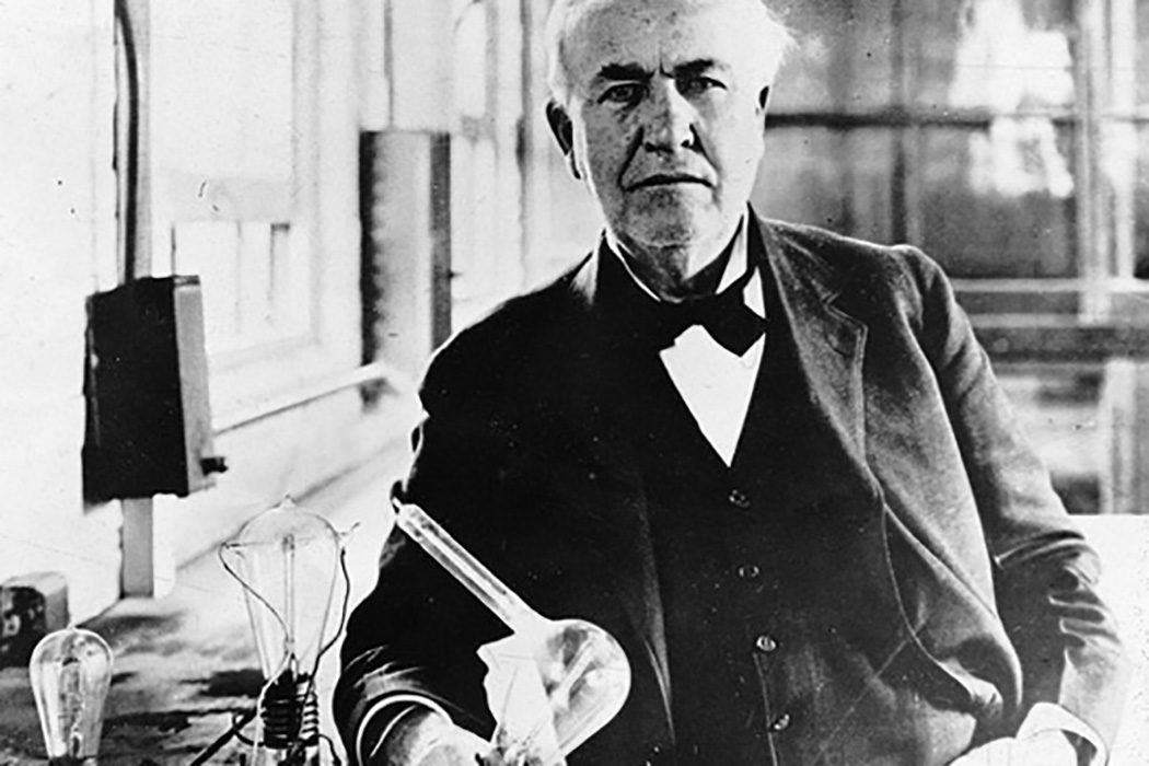 Thomas Edison with lightbulb