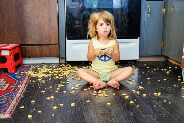 kid with food on floor