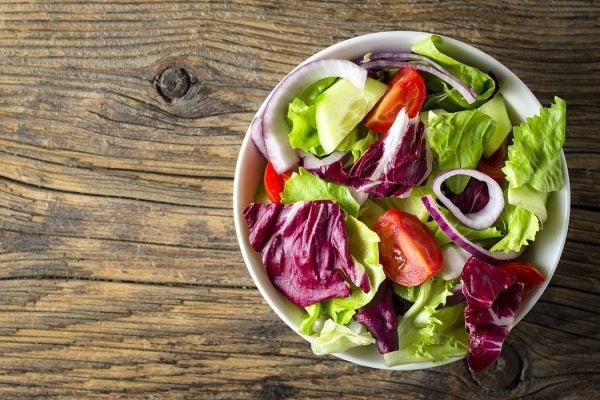 Fresh vegetables salad on wooden table