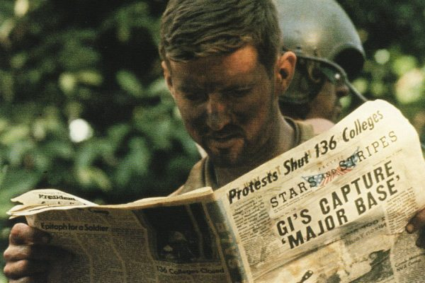 Soldier reading newspaper