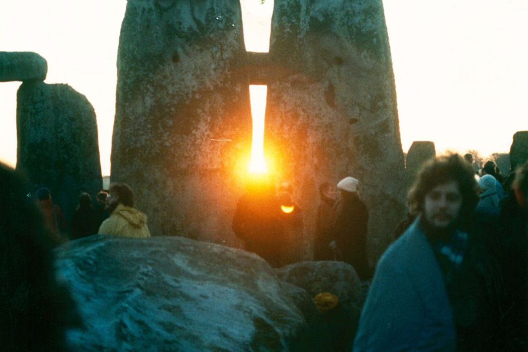 Photograph: 	 Sunrise between the stones at Stonehenge on the Winter Solstice in the mid 1980s.  Source: https://commons.wikimedia.org/wiki/File:StonehengeSunrise1980s.jpg