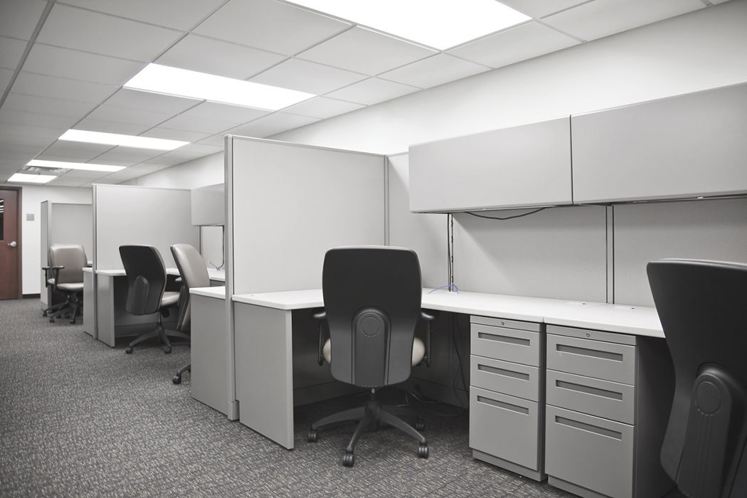 A row of empty office cubicles.